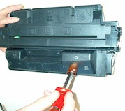 burning a hole to reill your toner cartridge